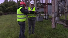Electricians take instruction before launch work Stock Footage