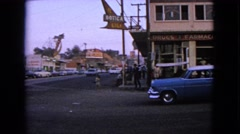 1963: cars traveling on the street in the city BARRINGTON, ILLINOIS Stock Footage