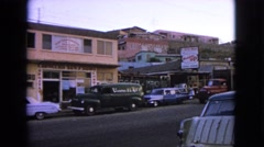 1963: a city road on day time with parked vehicles and busy environment Stock Footage