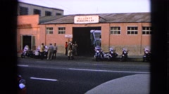 1963: cars are seen passing by a building BARRINGTON, ILLINOIS Stock Footage
