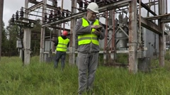 Disappointed electrician using tablet PC in substation Stock Footage