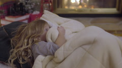 Siblings Wait For Santa, Play A Game, Hide Under Blanket, Peek Out Stock Footage