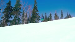 Young snowboarder downhill in slowmotion, snow-capped mountains. 1920x1080 Stock Footage