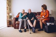 Elderly Couple with Home Carer Stock Photos