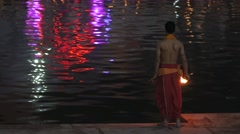 Hindu priest swinging torch at evening ceremony,Ujjain,India Stock Footage