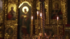 Candles burn on a background an iconostasis. Stock Footage