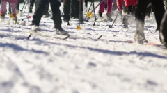 Mass ski race. Cross-country skiing race. The legs of skiers Stock Footage