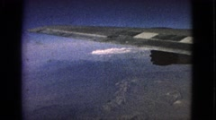 1963: looking out of a plane window while flying over some mountains BARRINGTON, Stock Footage