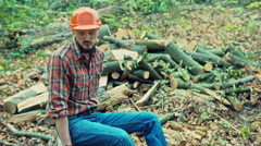 Young lumberjack resting after a hard day. RAW video record Stock Footage