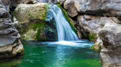 Waterfall flowing down a stone in a mountain river Stock Footage