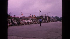 1963: two men in the center of the street with a large crowd gathered Stock Footage