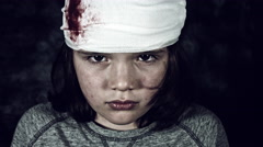 4k Dramatic Shot of a Injured Child looking with Bleeding Bandaged Head Stock Footage