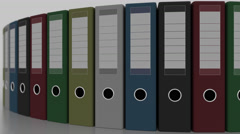 Rotating color office binders, shallow focus. 4K seamless loopable animation Stock Footage