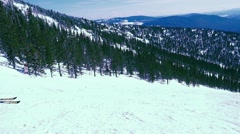 Skiers on downhill race with sun and mountain view in slowmotion. 1920x1080 Stock Footage