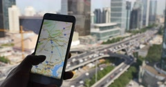 4k,human browse map on smartphone with business building & urban traffic backgr Stock Footage
