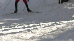 Slow-motion. The legs of skiers. Ski poles and cross-country skiing Stock Footage