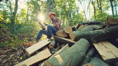 Young woodcutter work in the forest. RAW video record Stock Footage