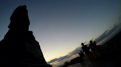Panorama hyperlapse historic monument at sunset with people walking around Stock Footage