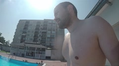Jumping into swimming pool, going underwater slow motion, POV experience Stock Footage