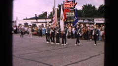1963: a band playing musical instruments as they march in rhythm  Stock Footage