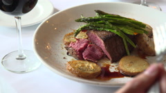 Fillet mignon being eaten Stock Footage