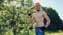 Lumberjack with an ax resting on his shoulder. RAW video record Stock Footage