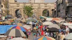 Busy market on Maidan with Teen Darwaja gate,Ahmedabad,India Stock Footage