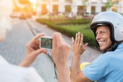 Man waving hand at camera. Stock Photos