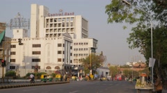 Central Bank building with street traffic,Ahmedabad,India Stock Footage