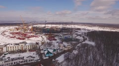 Drone flying over building of sporting stadium in winter day, snow is lying Stock Footage