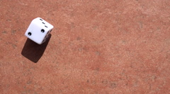 Tumbling dice on stone table Stock Footage
