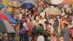 Busy market on Maidan Shahi with parasols,Ahmedabad,India Stock Footage