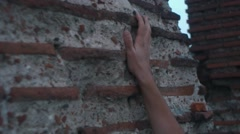 Hand touching ancient architecture ruins wall Stock Footage