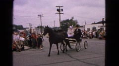 1963: horse and buggies parade through the cities downtown streets BARRINGTON, Stock Footage