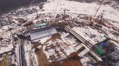 Aerial view of construction area of building of sporting stadium in winter time Stock Footage