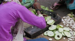 Woman cutting mangos on street,Ahmedabad,India Stock Footage