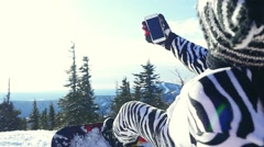 Snowboarder man in suit of kigurumi of zebra take selfie with phone over Stock Footage