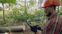 Lumberjack checks work. RAW video record Stock Footage