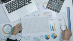 Financial specialist, businessman working with blueprint, graph at his workplace Stock Footage