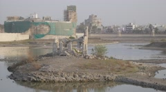 Ruins on island with Lakhota Museum in Ranmal lake,Jamnagar,India Stock Footage