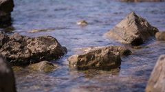 The crystal clear water on the shore of the Black Sea Stock Footage