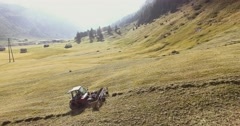 Tractor In Swiss Alps // Aerial Footage - Riprese Aeree // 4K Stock Footage