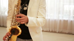 A man plays the saxophone Stock Footage