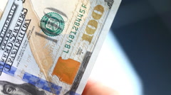 Man finds 100 dollar bills close-up Stock Footage