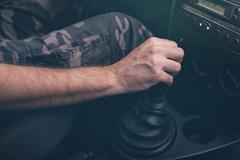 Male driver hand shifting gear manually Stock Photos