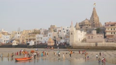 Dwarika jagat mandir termple and ghats and pilgrims,Dwarka,India Stock Footage