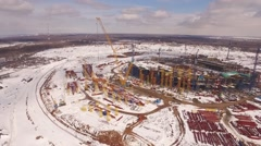 Beautiful winter aerial panorama of construction area of sporting stadium, drone Stock Footage