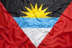 Textile flag of Antigua and Barbuda Stock Photos