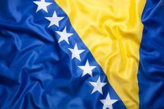 Textile flag of Bosnia and Herzegovina Stock Photos