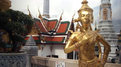 Golden statue at Grand Palace Temple in Bangkok,Thailand Stock Footage